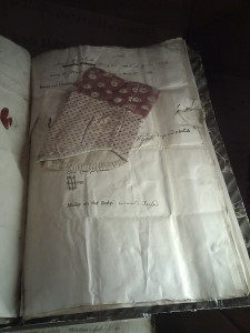 Child's Sleeve pinned to documents at the Foundling Hospital